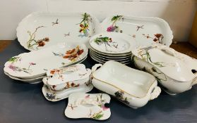 A selection of Haviland Limoges porcelain serving dishes, six shallow bowls and a sauce boat
