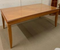 An eight seater dining table with glass top (H78cm W184cm D100cm)