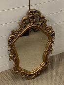 A gilt framed carved mirror