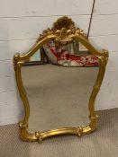 A gilt frame shield mirror (90cm x 55cm)
