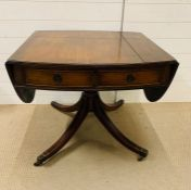 A mahogany style sofa table with twin hinged ends on a carved stem and four down swept legs with