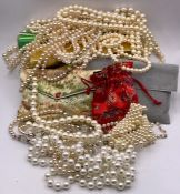 A Large volume of pearl necklaces in various styles and fashions with various makers.