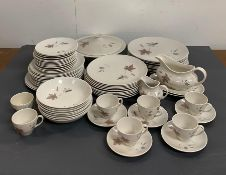 A substantial amount of Royal Doulton 'Tumbling Leaves' pattern china dinner service.