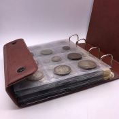 An Extensive album of Great British coinage to include Crowns, sixpences, pennies, halfpennies,