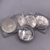 Five collectable silver coins