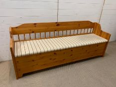 A Pine Bench Seat with upholstered seat with storage under (W 187 cm x D 50 cm x H 76 cm)