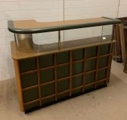 A Mid Century Bar with lattice design front and glass fronted shelves with downlighters.