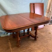 A square dining table with two centre leaves on carved legs (W108cm D105cm) (Each leaf W46cm)