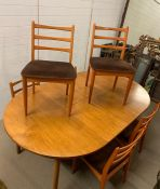 A Schreiber Dining Table and Six Chairs