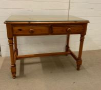 A pine desk with two drawers and a glass top 100cm L x 58cm D x 78cm H