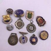 A Small selection of pin badges including some silver.