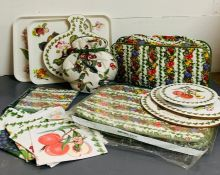 A selection of Pomonia Portmeirion place settings, trays and napkins