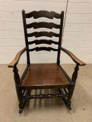A ladder back rocking chair