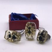 A Vintage set of resin Gents cuff links set round bugs