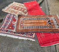 A selection of four pattern rugs to include one runner (180cm x 128cm, 132cm x 87cm, 164cm x 88cm,