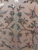 A pair of two early 20th century Chinese silk embroidery panels, depicting courtesans, flora and