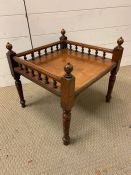 A low table with spindles to three sides