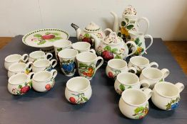 A selection of Pomona Portmeirion china including teapot, mugs, cups and cake stand