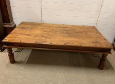 An Indian Hardwood Coffee Table with metal stretchers (W 159 cm x D 89 cm x H 45cm)