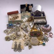 A Large Volume of Costume Jewellery to include earrings, bracelets etc.