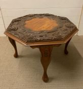 A Carved incidental table (D 66 cm x H 46 cm)