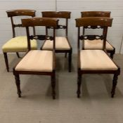 A set of four regency style dining chairs, shaped rectangular backs, carved pierced splats and