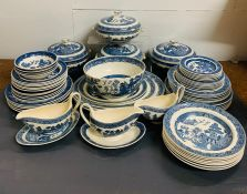 """A large selection of Wedgwood """"Willow"""" pattern china, to include various size plates, lidded dishes,"""