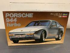 A boxed model kit of Porsche 944 Turbo