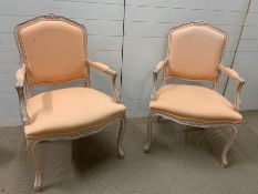A pair of Louis XV style fauteuils (chairs) with cartouche shaped backs, arms and seats on