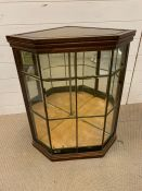 A Glass terrarium or display cabinet in a corner style.