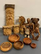 A selection of turned wood items to include carved horses, bookends and lidded pots