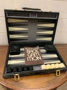 A Bach Gammon set in suede case
