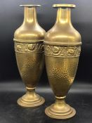 A pair of brass mantle vases