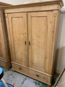 A two door pine wardrobe with two drawers under (H185cm W128cm D60cm)