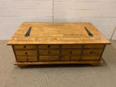 A pine coffee table with drawers to side (118cm x 66cm)