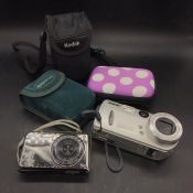 A mixed selection of compact cameras, five in total