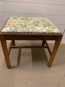 An oak dressing table stool