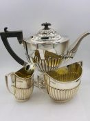 A Three piece hallmarked, harlequin tea service (Approximate weight 980g) various hallmarks and
