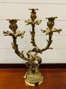 A Three arm brass candelabra