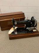 A Frister & Rossman case Vintage sewing machine.