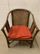 A cane and bamboo style chair