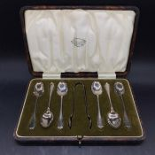 A Cased set of silver six teaspoons and sugar tongs