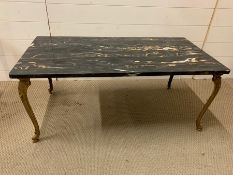 A marble topped coffee table on brass scrolled feet (H43cm W102cm D51cm)
