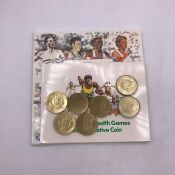 Two pound coins, two uncirculated 1995 nations united for peace, two 1986 commonwealth games and