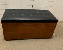 A G-Plan teak blanket box with black button back seat (H48cm W94cm D46cm)