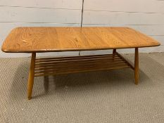 A 1960's Ercol Elm coffee table (H37cm W105cm)