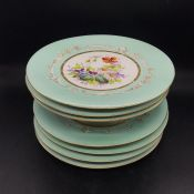 Six decorative floral cake plates and cake stand