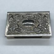 A White metal match box holder