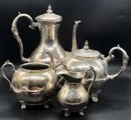 A Silver plated tea service to include tea and coffee pot, along with sugar bowl and milk jug