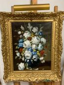 A 20th century English school, Flowers in a blue vase, unsigned, oil on canvas, within an impressive